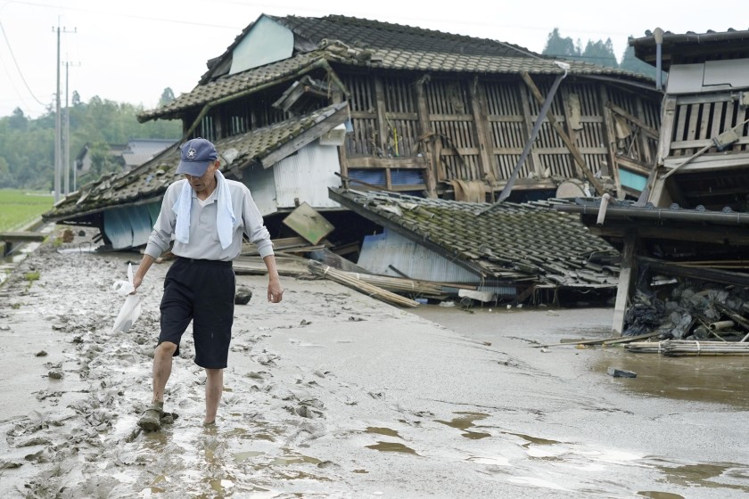 Japan floods leave up to 34 dead