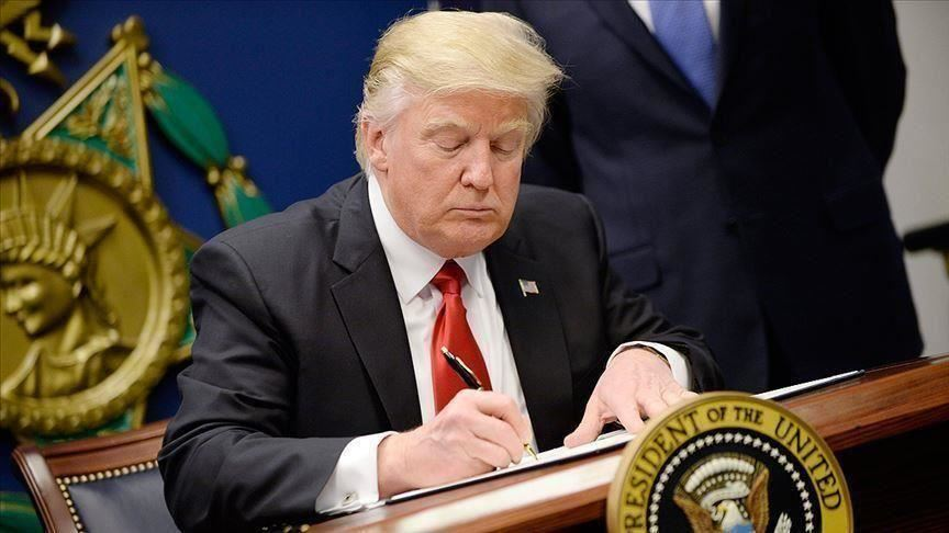 US President Donald Trump signs bill to impose sanctions on Chinese officials
