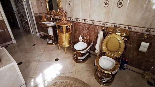 Russia: Golden toilet, kitchen, halls found in cop
