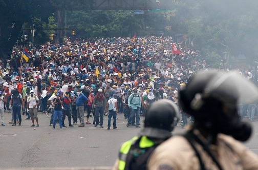Venezuela pro-government protester dies, raising toll to 21