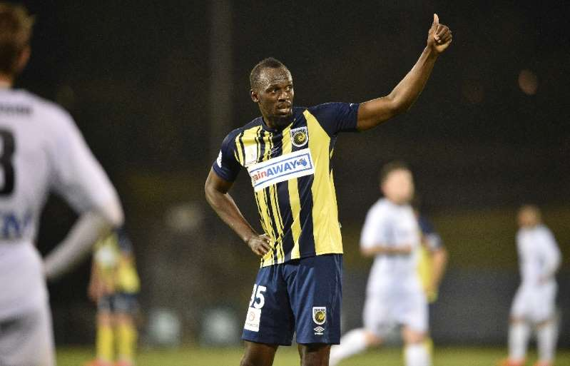 Bolt hanging up boots on football dream
