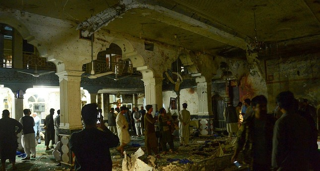 At least 72 killed in suicide bombings at two Afghan mosques, IS claims attack