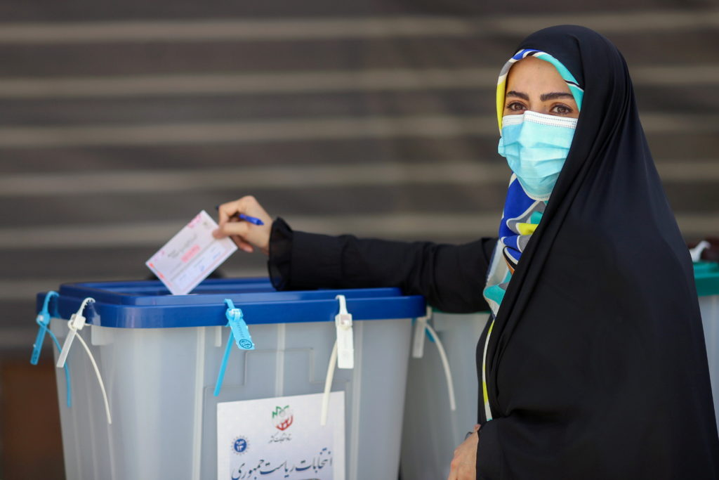 Iran votes in presidential poll tipped in hard-liner
