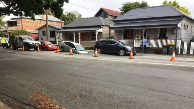 Sinkhole swallows parked car in Newcastle, Australia