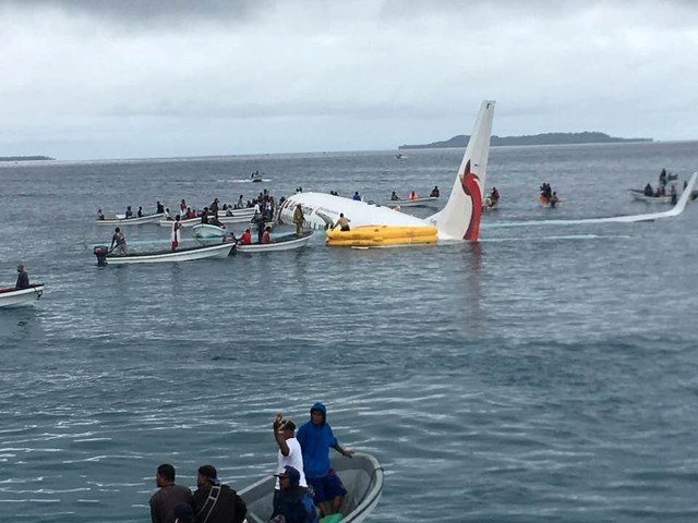 Plane misses runway and crash lands in Pacific lagoon - all passengers and crew survive