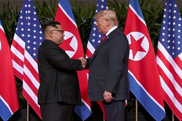 Trump meets Kim Jong Un at historic summit in Singapore