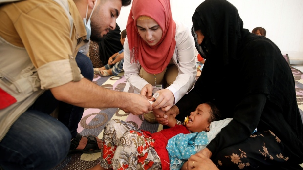 Hundreds suffer food poisoning in Iraqi displaced camp