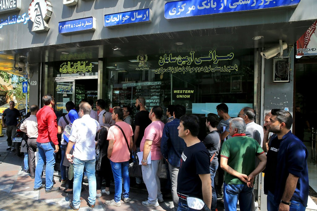 Iran's Currency Crashes. Shortages and Fears Rise.