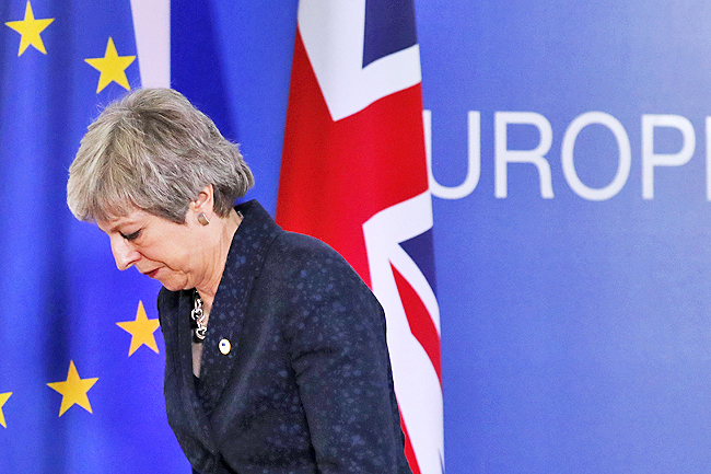 British PM isolated as Brexit strategy hangs in the balance