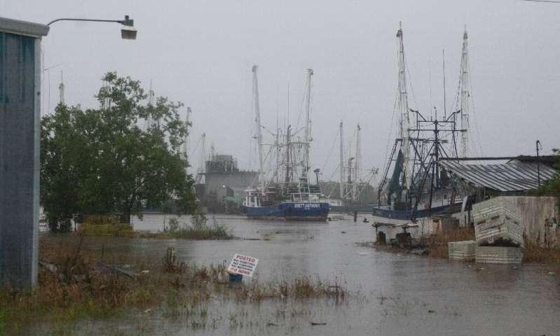 US warnings of heavy rain, tornadoes from weakening storm Barry