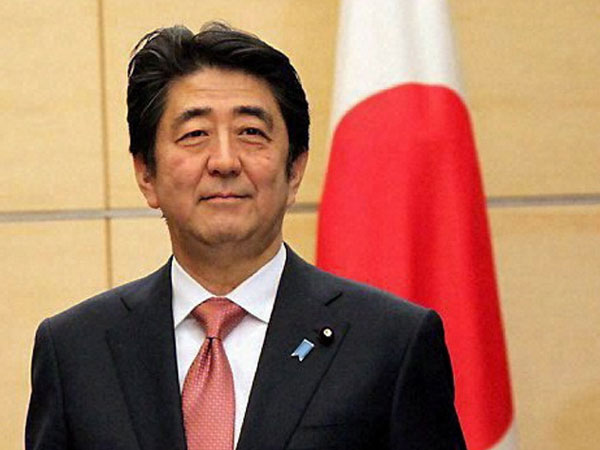 Shinzo Abe claims landslide victory in Japan elections
