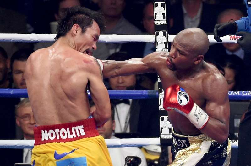 Mayweather rematch closer as Pacquiao signs to face