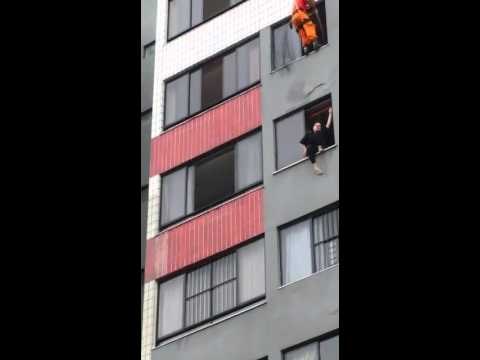 Firefighter saves suicidal woman by kicking her inside