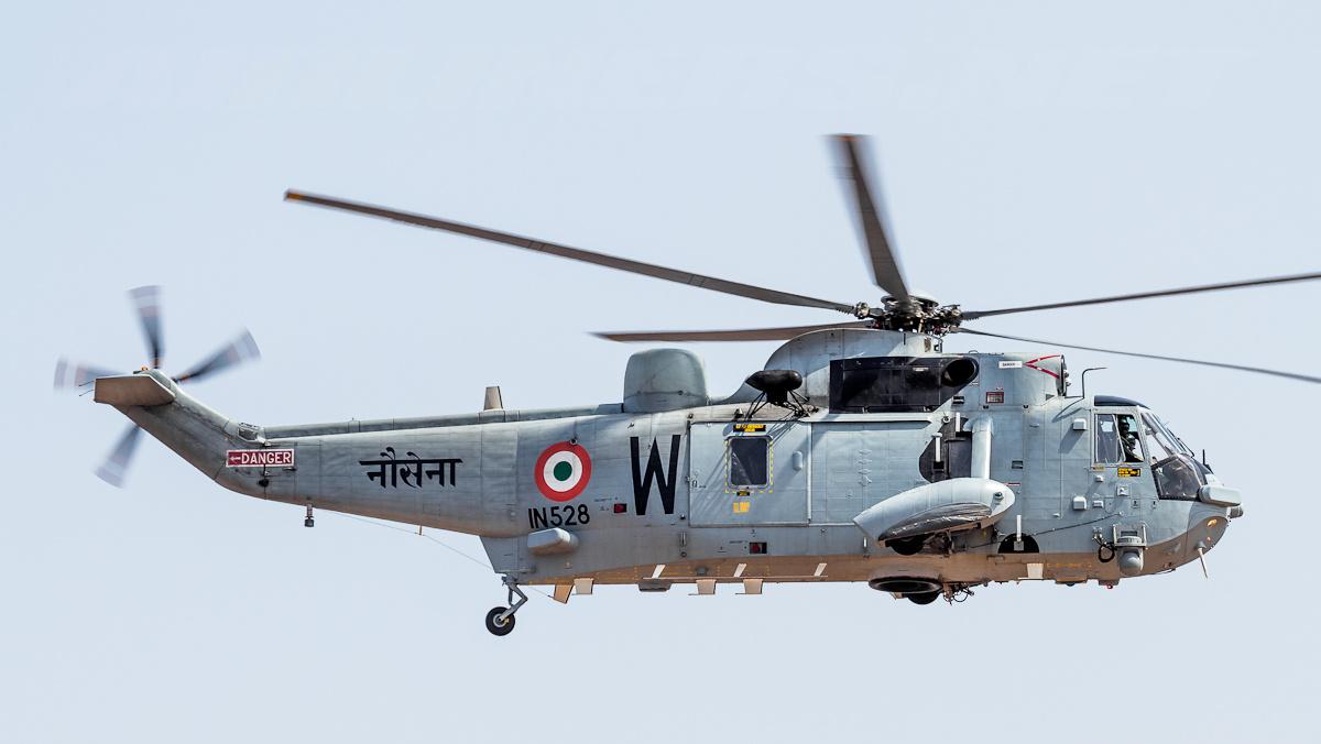 indiannavyhelicoptersundertakeaerialseedingatvisakhapatnam