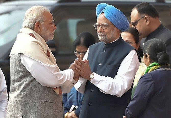 Week after Aiyar dinner row, Modi, Manmohan shake hands