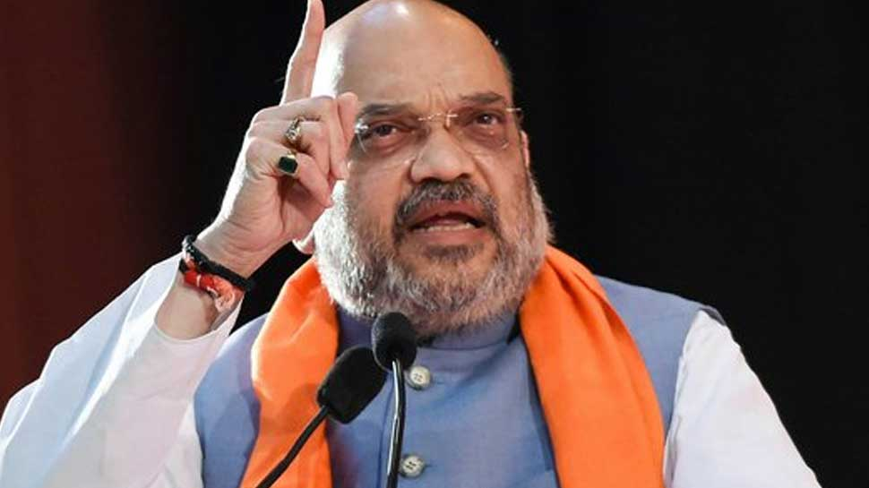 Amit Shah takes on Congress over Article 370, Rafale shastra pooja