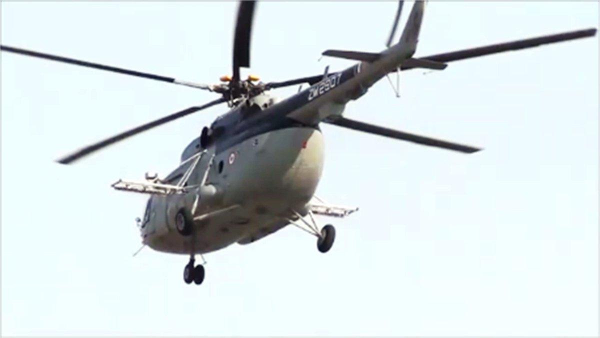 unionministernstomarflagsoffbellhelicopterwithsprayequipmentforlocustcontrol