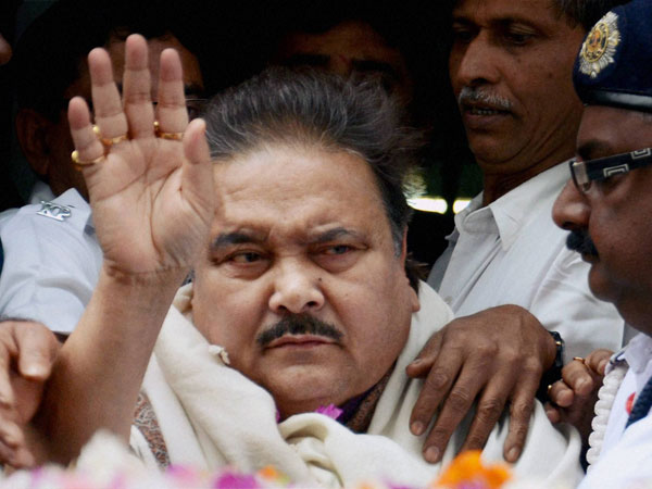 Madan Mitra surrenders in court