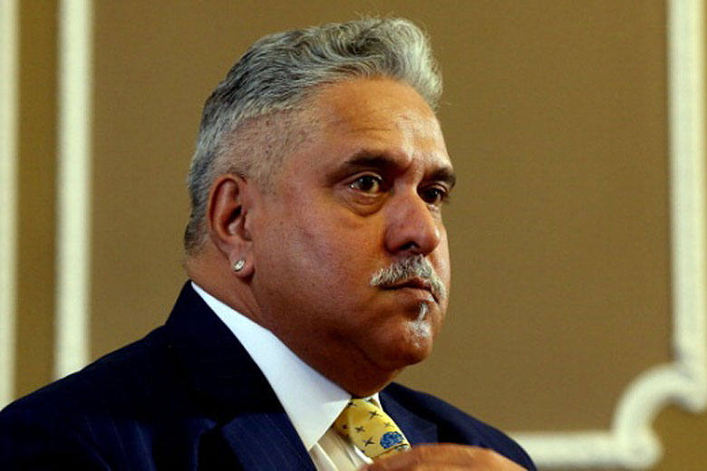 I am like a football being kicked around by two teams: Vijay Mallya