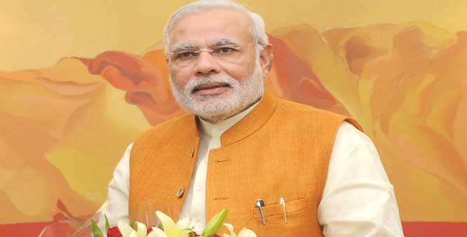 Modi greets  people on