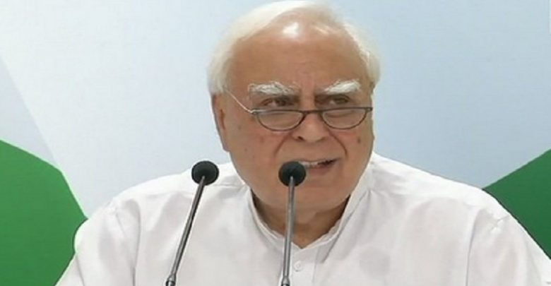 PM should attend to work, have less photo ops: Kapil Sibal