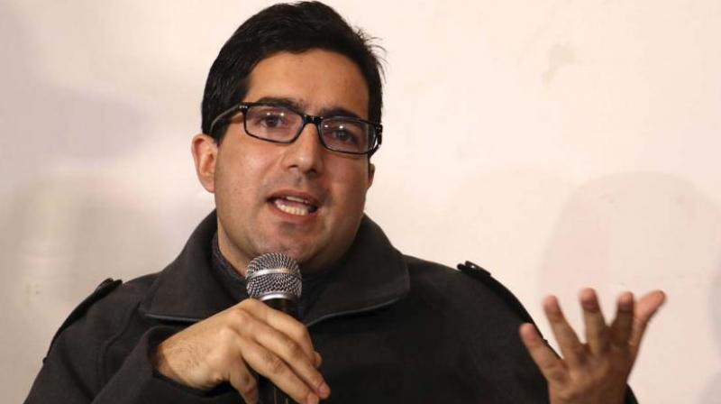 Former IAS officer Shah Faesal detained by authorities at Delhi airport and sent back to Kashmir
