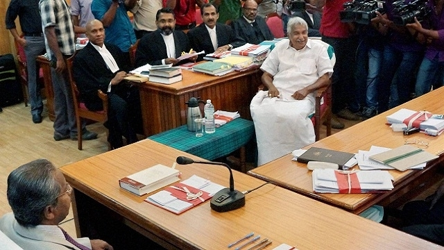 Kerala CM Chandy presents budget amid protests by Opposition