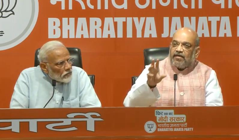 Modi at his first media event diverts questions to Shah, asserts BJP will be back in power