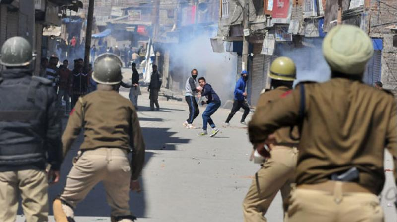 4 injured as security forces fire on mob after