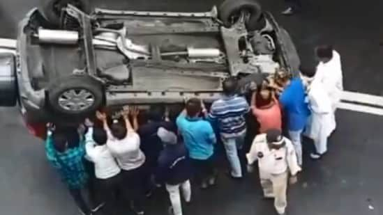 People in Mumbai help put overturned car back on its wheel, video goes viral