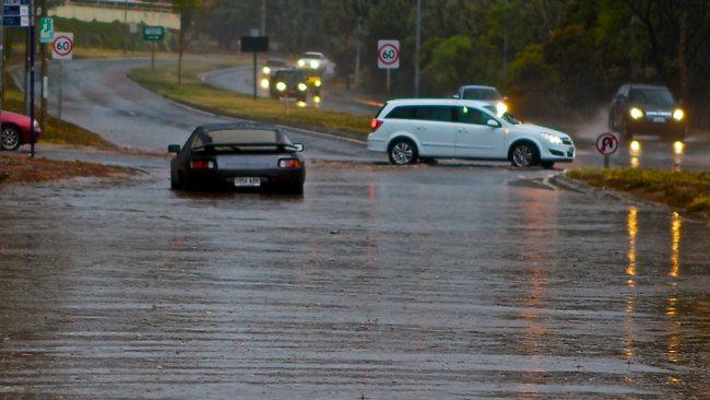 Flash floods kill 5 as torrential rains hit Australia