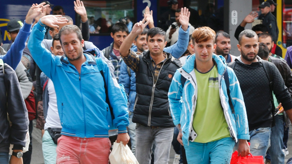 Thousands of asylum-seekers reach Germany